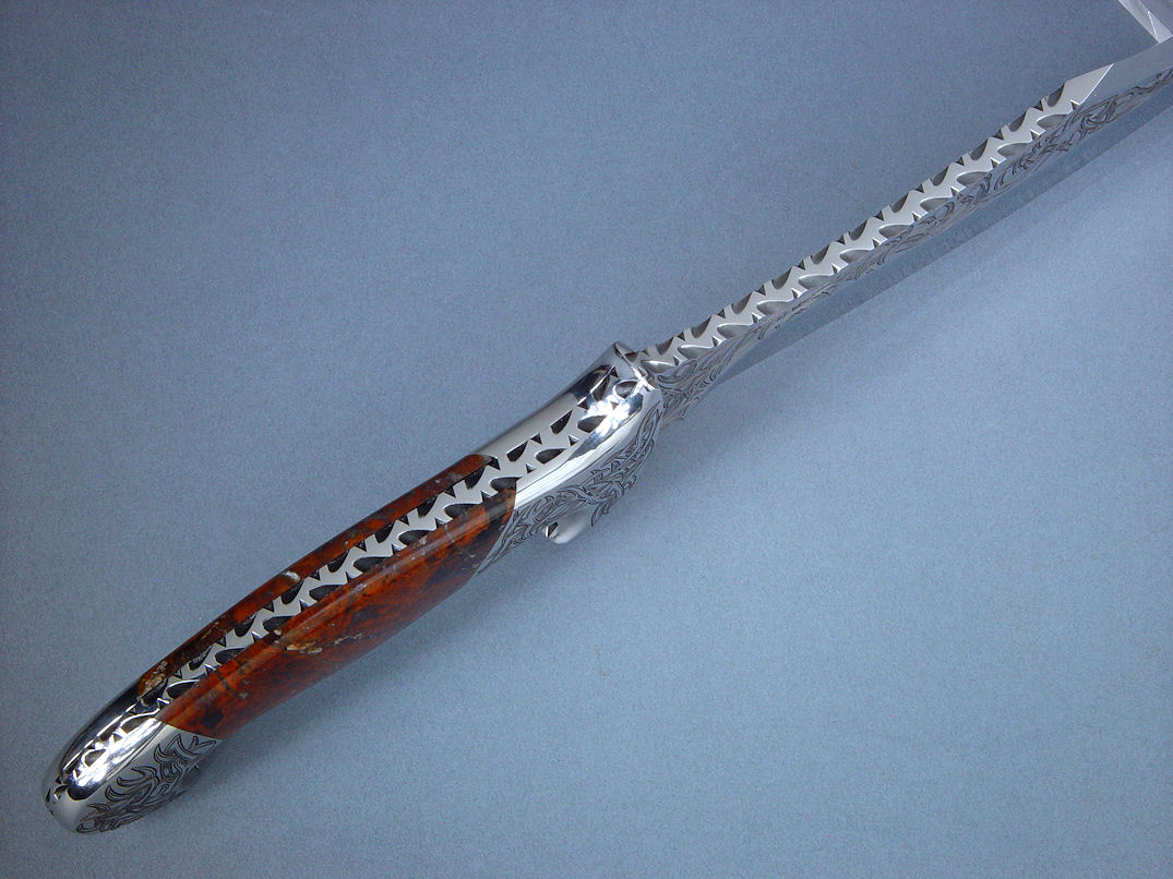 """Tribal"" (Helhor pattern) spine edgework, filework detail. Filework is full and bold around tapered tang of handle"