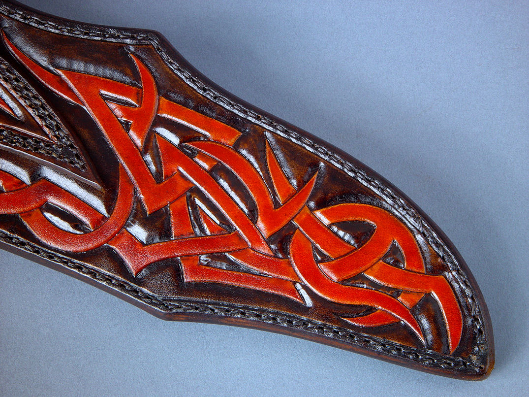 """Tribal"" (Helhor pattern) sheath, back view. Sheath is entirely hand-carved and meticulously hand-dyed in leather shoulder, front and back, and hand-stitched in black nylon"