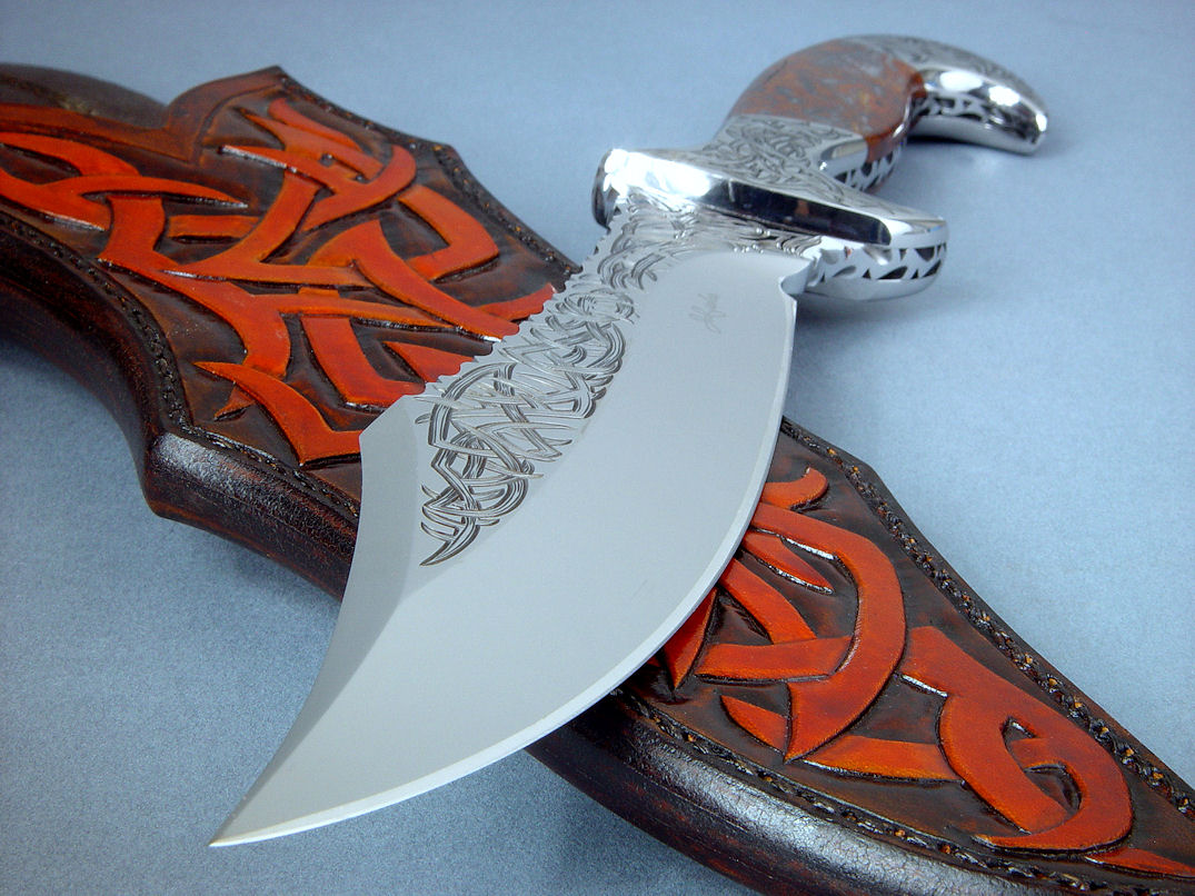 """Tribal"" (Helhor pattern) point detail. Knife is deeply hollow ground with a clip point swage and razor keen cutting edge."