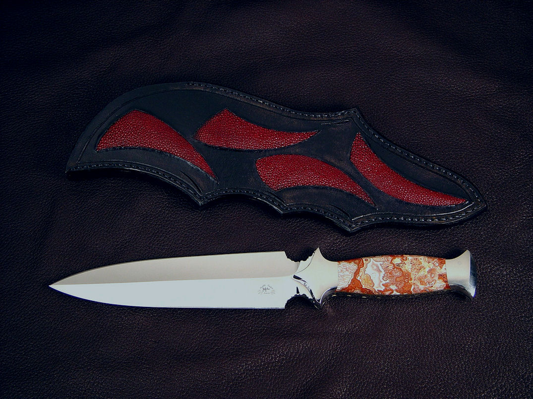 """Troll Magnum"" obverse side view in 440C high chromium stainless steel blade, 304 stainless steel bolsters, Crazy Lace Agate gemstone handle, sheath of red rayskin inlaid in hand-carved leather shoulder."