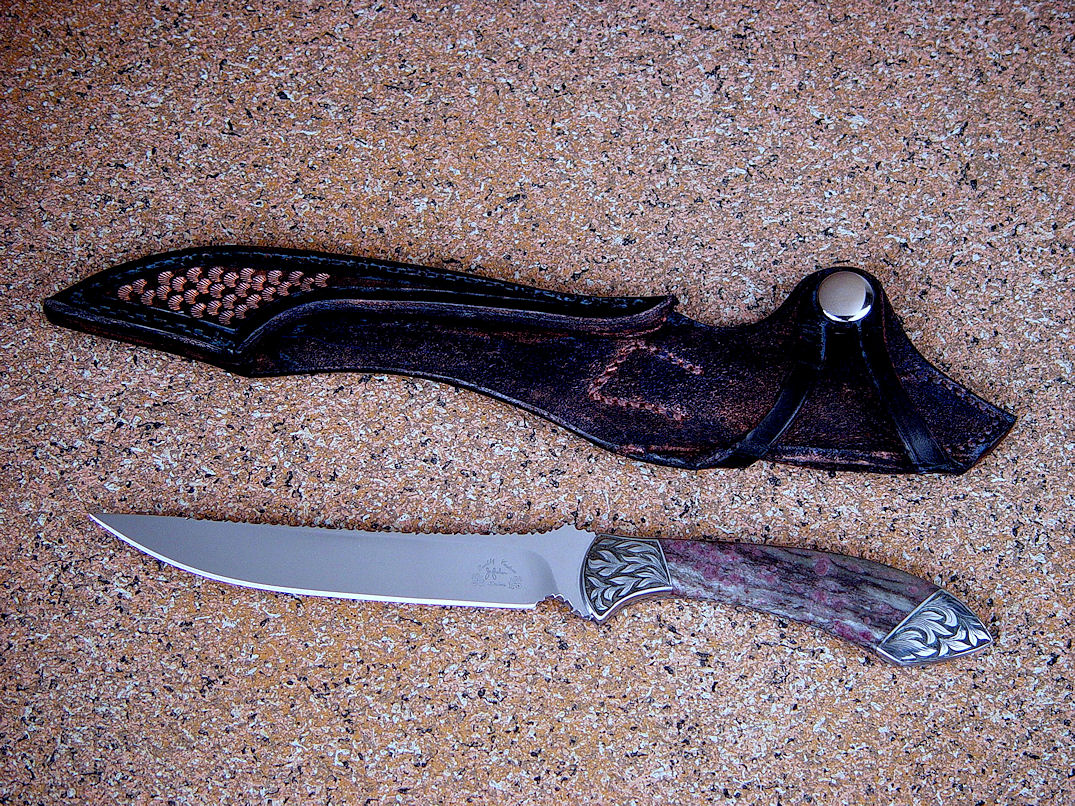 """Tusas"" obverse side view in 440C high chromium stainless steel blade, hand-engraved carbon steel bolsters, Ruby in Zoisite gemstone handle, hand-tooled, bronze-washed leather sheath"