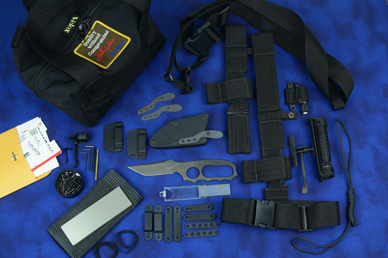 """Veloxi"" complete tactical knife kit with knife, sheath, hardware, fasteners, straps, loops, UBLX, EXBLX, LIMA, two sharpeners, sternum harness, HULA, two flashlights, spare parts, lanyard, and duffle"