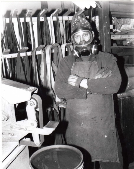 The Knife Maker in full safety gear in his element: steel, dust, abrasives