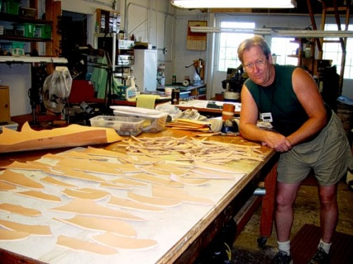 Jay with leather work: many knife sheaths under construction