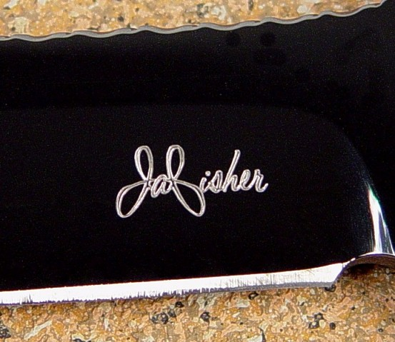 Knife maker's mark of Jay Fisher diamond engraved on mirror finished blued O-1 tungsten-vanadium tool steel blade