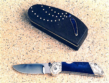 "My ""Pinon"" folding knife, mid-1980s, with sodalite handle and engraved nickel silver bolsters"