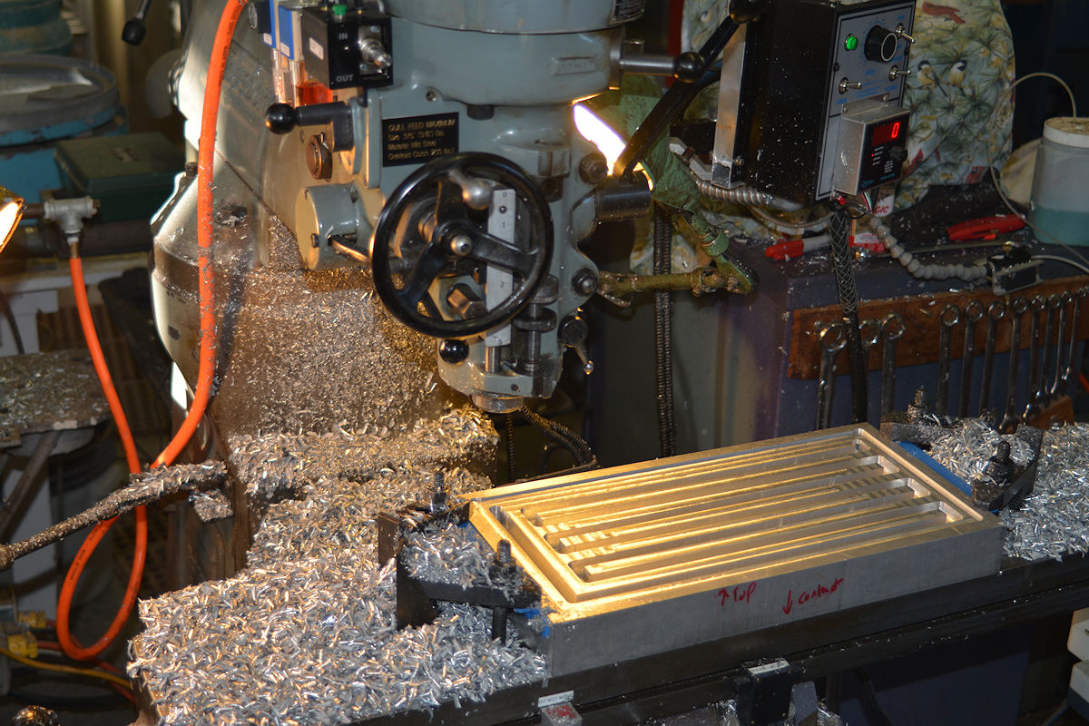 Milling the heat exchanger pathways in a contact quenching block of aluminum