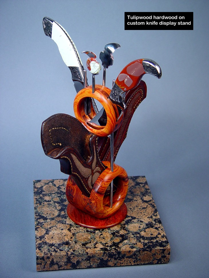 Tulipwood is used in the sculputural rings of this custom knife display stand