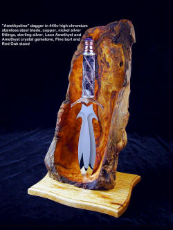 """Amethystine"" dagger in 440C high chromium stainless steel blade, diffusion welded copper, nickel silver fittings, Lace Amethyst, sterling silver handle with Amethyst crystal, Ponderosa Pine burl and Red Oak stand"