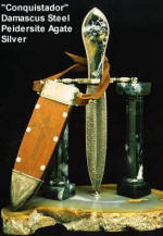 "Fine investment grade knives and daggers: damascus steel, blued steel, carved leather, gemstone handles and stands: ""Conquistador"""