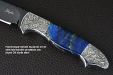 """Carina"" obverse side view in mirror polished and hot-blued O1 high carbon tungsten-vanadium tool steel blade, hand-engraved 304 stainless steel bolsters, Labradorite gemstone handle, hand-carved, hand-dyed leather sheath"