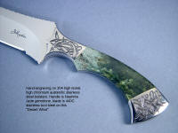 """Desert Wind""  Persian Dagger in 440C high chromium stainless steel blade, hand-engraved 304 stainless steel bolsters, Mossy Nephrite Jade gemstone  handle, stainless steel engraved sheath, Wenge, Cocobolo, Purpleheart hardwood, with custom display stand"