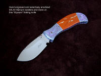 """Elysium"" liner lock folding knife, obverse side view in ATS-34 high molybdenum stainless steel blade, hand-engraved titanium bolsters and liners, Red River Jasper gemstone handle, Anthorsite stone case"