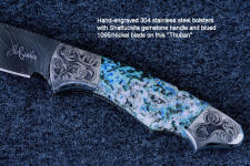 """Thuban"" obverse side view in hot-blued 1095/nickel damascus blade, hand-engraved 304 stainless steel bolsters, Shattuckite gemstone handle, hand-carved, hand-dyed leather sheath"