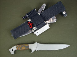 """Anzu"" tactical combat knife, reverse side view. Sheath has ultimate belt loop extender and accessory package including sharpener, fire starter, and flashlight"