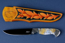 """Aquila"" obverse side view without white reflector in mirror polished and hot blued O1 high carbon tungsten-vandium tool steel blade, hand-engraved 304 stainless steel bolsters, Golden Plume Agate gemstone handle, hand-carved, hand-dyed leather sheath"