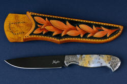 """Aquila"" obverse side view. This shot has the white reflector to illustrate the grind lines.Blade is hot-blued O1 tungsten-vanadium tool steel, with hand-engraved 304 stainless steel bolsters, and Golden Plume Agate gemstone handle with hand-carved, hand-dyed leather sheath"