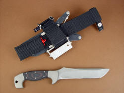 """Arctica"" fine survival, combat, tactical, handmade knife, reverse side view. The knife has a complete accessory package mounted to the tough polypropylene belt loop extender"