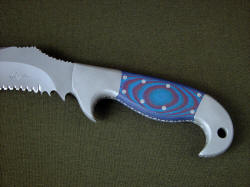 """Arcturus"" obverse side handle detail. Handle scales are blue and red G10 fiberglass/epoxy composite laminate, extremely hard, tough and durable, secured with eight stainless steel pins"