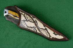 """Argyre"" sheathed view. Sheath is deep and protective, with beautiful inlay panels of Python skin in heavy leather shoulder."