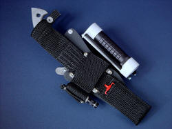 """Ari B'Lilah"", reverse side sheath view. Ultimate belt loop extender allows lower wear position on belt line, holds backup emergency led solitaire Maglite, diamond pad sharpener, is waterproof and durable."