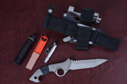"""Ari B'Lilah reverse side view, with sheath back and accessories: MagTac extreme LED high power tactical flashlight, DMT diamond abrasive sharpener, and Maglite Solitaire LED back-up flashlight with retainer"