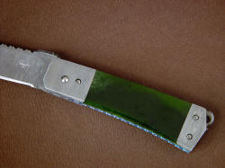 """Aries"" obverse side handle detail. Pounamu is New Zealand Nephrite Jade gemstone, hard, tough, and durable with a bright, translucent finish"