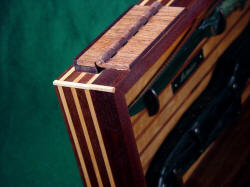 """Astarion"" case corner detail. Note red lauan (Philippine Mahogany)  hinges, spline jointery in corners."