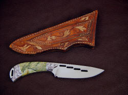 """Bootes"" reverse side view. Note full carving and bronze metal wash on sheath back including belt loop"