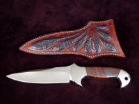 """Cygnus-Horrocks"" custom handmade knife, obverse side view in 440C high chromium stainless steel blade, 304 stainless steel bolsters, Australian Tiger Iron gemstone handle, Ostrich leg skin inlaid in hand-carved leather shoulder"