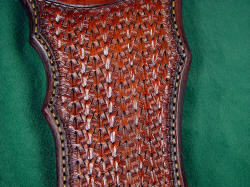 """Flamesteed"" sheath detail: tooling pattern is complex weave and tucked basketweave."