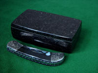 "Showing the reflective polish of the Black Galaxy Granite case for this ""Gemini"" folding knife"
