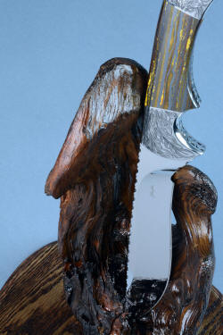 """Golden Eagle"" detail of knife in stand view. Many positions are available withthis natural aged stand."