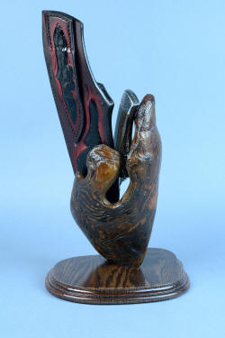 """Golden Eagle"" custom knife with burl wood stand base holding knife and sheath"