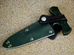"""Grim Reaper"" sheathed view. Note retention method. Leather strap has snaps on both ends, snaps are screw-attached to sheath through welts for maximum dependability"