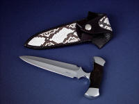 """Grim Reaper"" obverse side view in ATS-34 high molybdenum stainless steel blade, 304 stainless steel bolsters, Petrified Palm Wood gemstone handle, kydex, aluminum, nickel plated steel sheath, Python skin inlaid in hand-carved leather sheath"