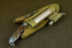 """Hooded Warrior"" shown with coyote tan locking sheath and HULA and matching LIMA flashlight accesories"