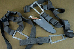 """Hooded Warrior"" modular black sheath wear system components: sternum harness, belt loop extender, spine harness"