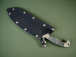 "Sheathed view: ""Horrocks"" locking combat sheath is stainless steel, kydex, aluminum"