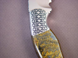 """Iraca"" reverse side front bolster engraving detail. Bronzite Hypersthene is a chatoyant, spangled, metallic gemstone."