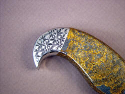 """Iraca"" handmade fine knife, reverse side rear bolster detail. Note beautiful golden color with metallic hematite in gemstone handle."