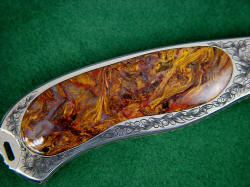 """Izar"" reverse side gemstone handle scale detail. Pietersite agate has chatoyant (cat's eye) light play effect in striking colors"