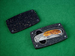 """Izar"" folding knife, in black galaxy granite case. Stainless steel pins align and secure top in hand-carved granite"