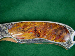 """Izar"" liner lock folding knife, obverse side handle gemstone detail. Pietersite agate is rare and beautful, brecciated tiger's eye quartz and agate"