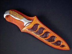 """Kapteyn"" sheathed view. Sheath protects blade and owner, frames beautiful and striking gemstone handle scales"