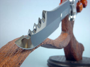 """Kochel"" knife point on display stand detail. On the swage alone, there are 24 independent grind surfaces, all matched and mirror polished"