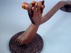 """Kochel"" custom knife display stand, rear view. Hand-carved walnut blends well with other dark hardwoods: cocobolo, wenge, Honduras rosewood"