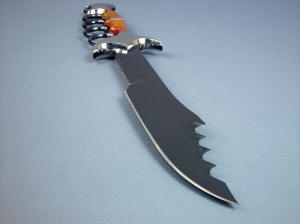 """Kochel"" knife blade point detail. This is an aggressive and beautiful work of knife art. Note front bolster faces sculpted and polished"