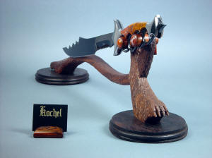 """Kochel"" front right view. The llines of the knife and stand work together, looking like a dark forest beast"