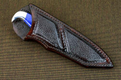 """Last Chance"" sheathed view. Sheath has large panel inlays of buffalo skin, knife is deeply protected in tough and sealed sheath"